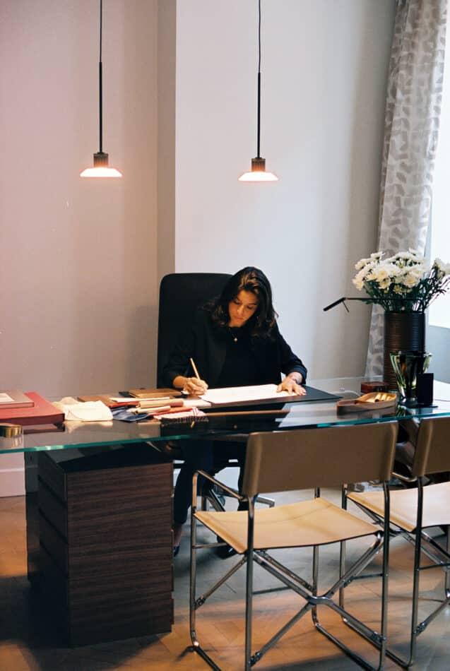 Alessia Genova at her desk