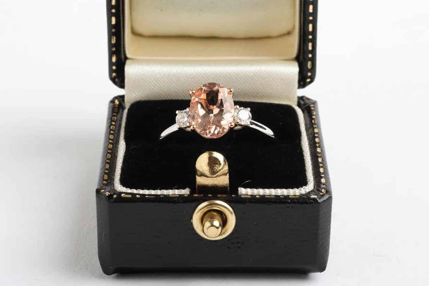 Morganite cluster ring with two brilliant-cut diamonds