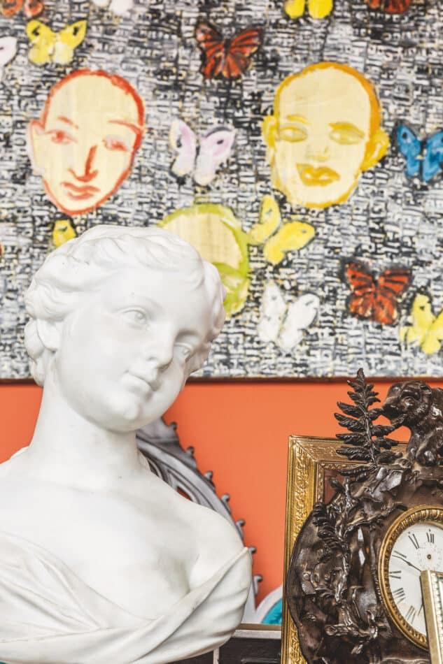 A Parian marble bust and the Hunt Slonem painting Citizen Bhagavan Butterflies