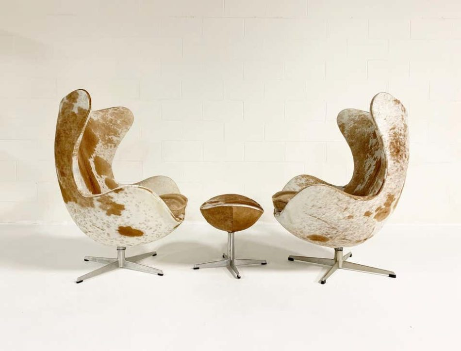 Egg chairs and ottoman reupholstered in Brazilian cowhide.