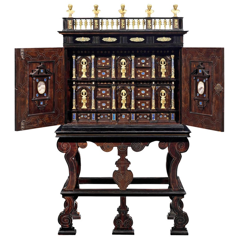 A 17th-century cabinet of curiosities features ebony wood and gilt bronze details.