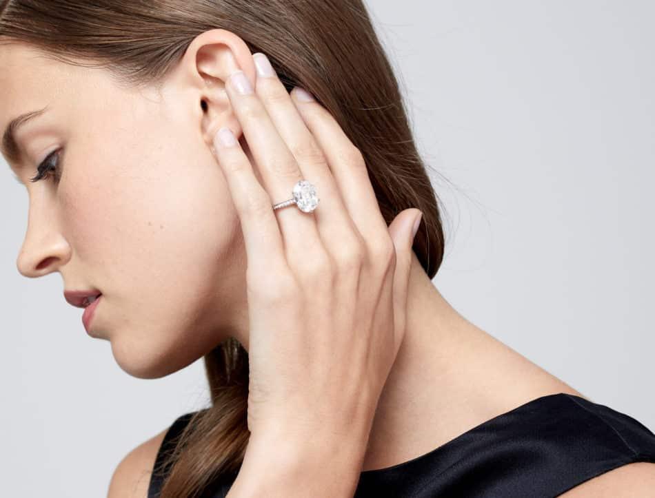 oval diamond engagement ring on model