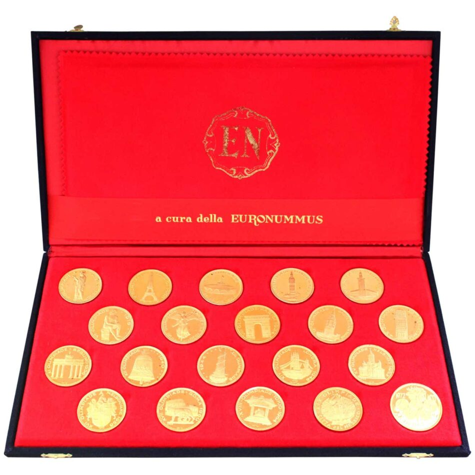 Red box with 20 gold coins, with each coin showing the first 20 Olympic Games, including locations, city landmarks, and the Olympic Torch Bearer