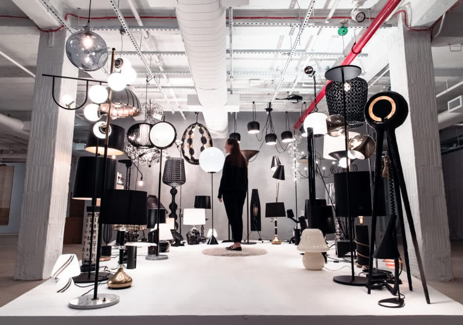 """A visitor activates the """"Enlightened"""" display at the 1stdibs Gallery."""