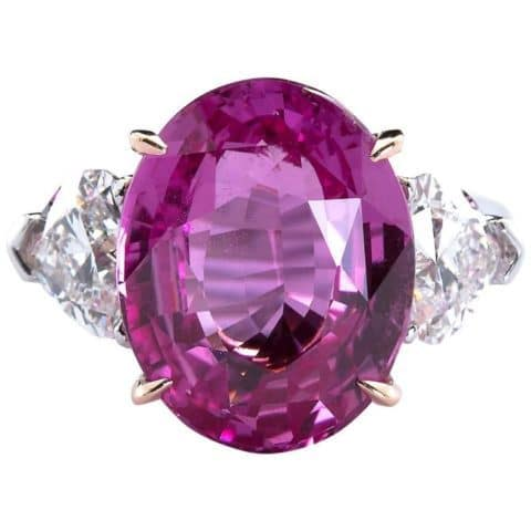 A 9.5-carat step-cut pink fancy sapphire ring. Offered by TMW Jewels.