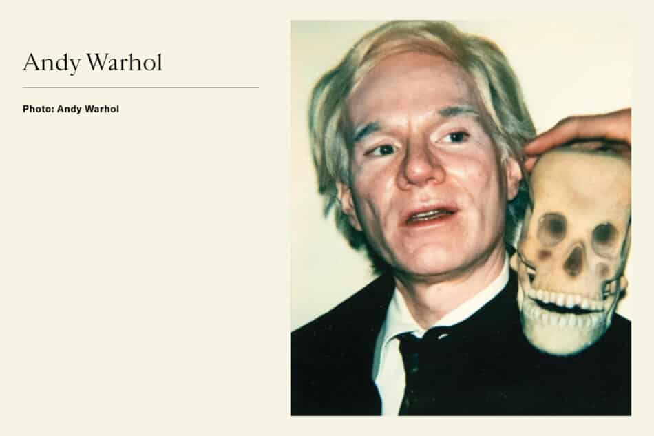 Portrait of Pop Artist Andy Warhol with skull on his shoulder
