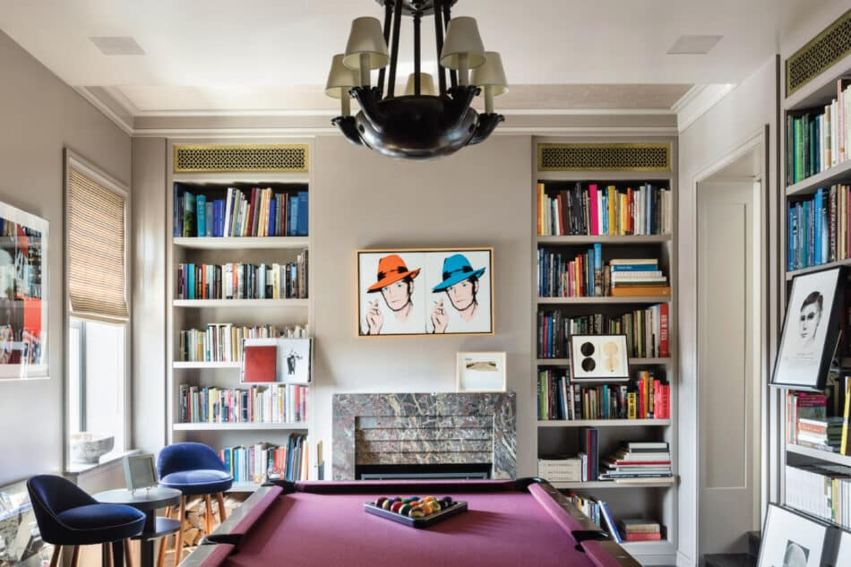 A billiards room designed by Thad Hayes features a Warhol double portrait of Truman Capote over the fireplace.
