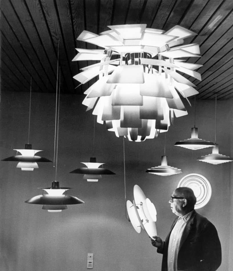 Poul Henningsen, photographed in 1957 among several of his designs, as seen in the book Danish Lights