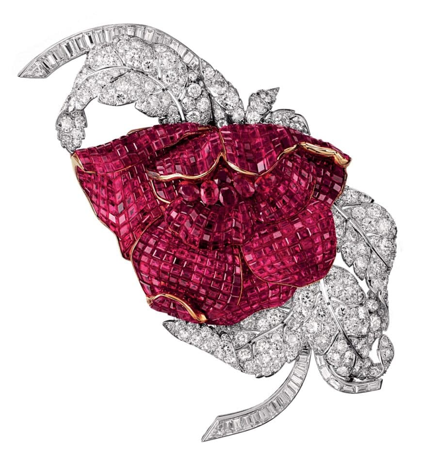 A 1937 Van Cleef & Arpels peony clip featuring curved petals with Mystery Set rubies