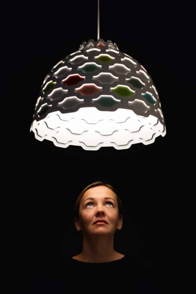 Louise Campbell with the Shutters Collage pendant lamp, as seen in the book Danish Lights