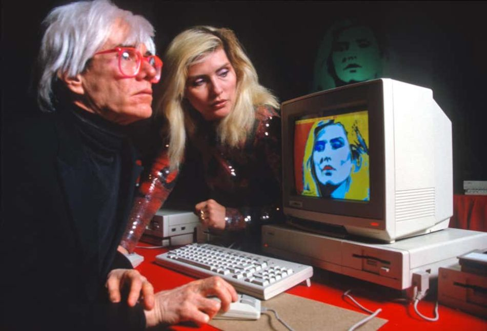 Andy Warhol with Debbie Harry and His Amiga Computer, 1985, by Allan Tannenbaum