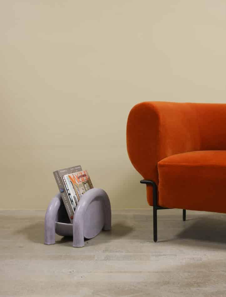 BZippy Magazine Rack in Lavender Milky Way next to orange seating