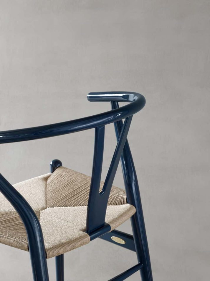 The 70th anniversary Wishbone chair with a glossy navy finish.