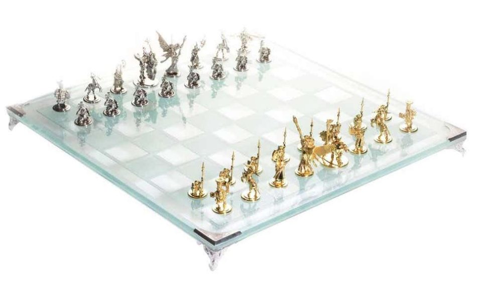 Gold and tempered glass chess set