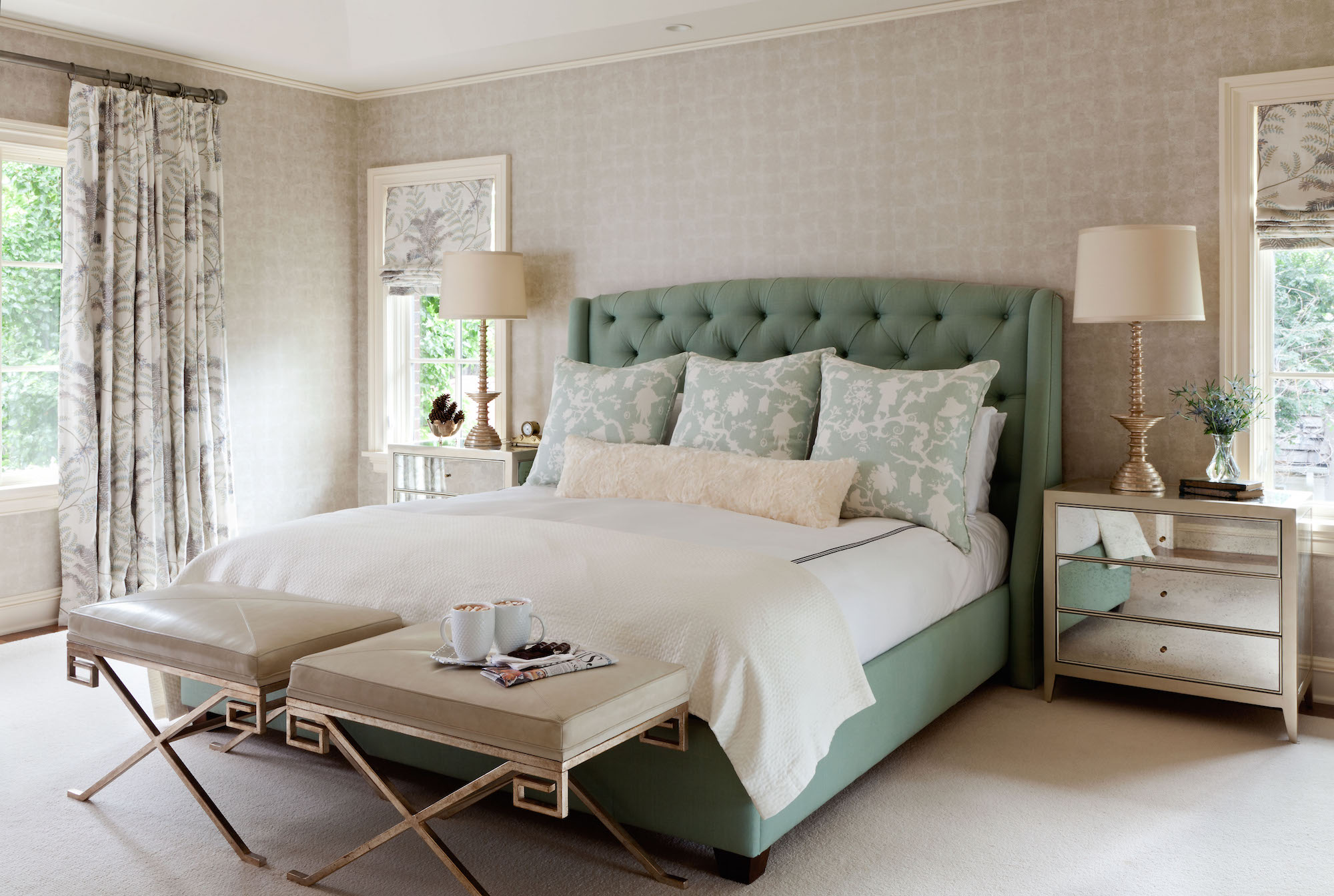 Tamba wallpaper by Osborne & Little wraps the bedroom walls in tranquility. Further subtleties come from custom draperies in Rochelle by Colefax and Fowler and custom pillows donning a modernized chinoiserie Shantung Silhouette print by Schumacher. Photo by Emily Minton Redfield