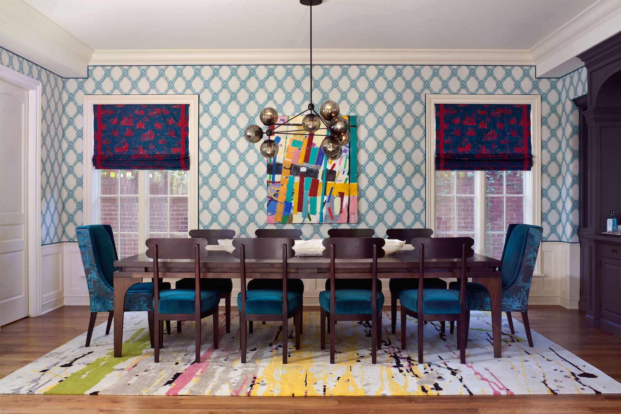Designer Andrea Schumacher covered A. Rudin head chairs in Schumacher velvet and a Sansui three-dimensional cut velvet by Donghia. Brunschwig & Fils' Bamboo Trellis pattern climbs the walls of the dining room. Photo by Emily Minton Redfield