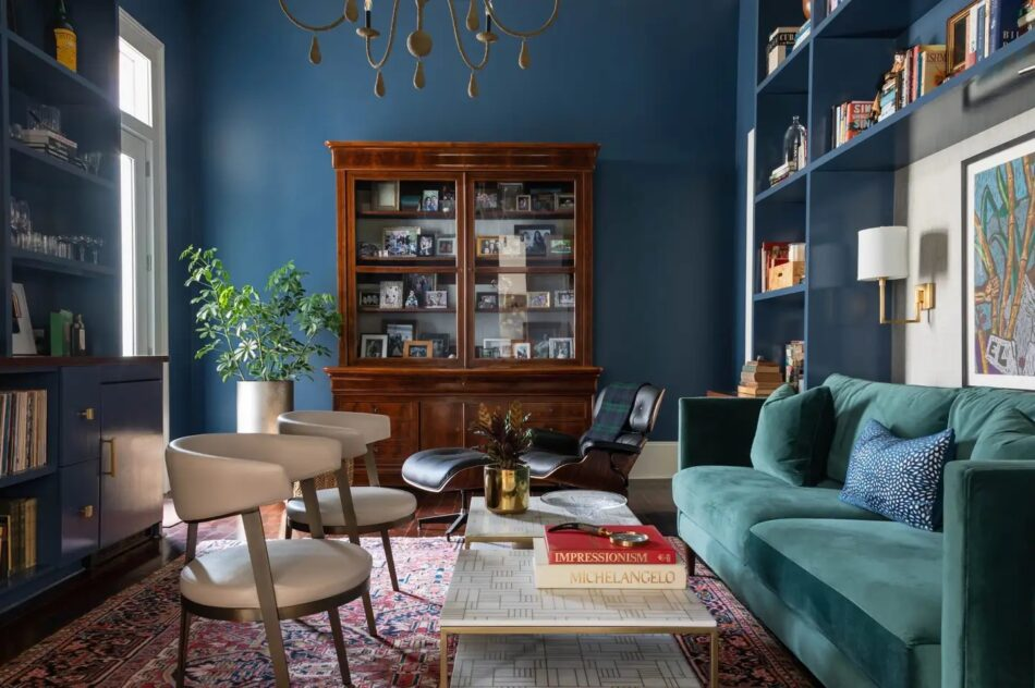 A New Orleans living roomd esigned by Eclectic Home featuring a vintage Turkish rug