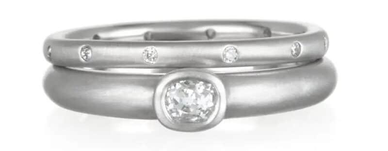 Faye Kim platinum and diamond eternity band, 2020, and platinum bezel-set-diamond ring, 2019