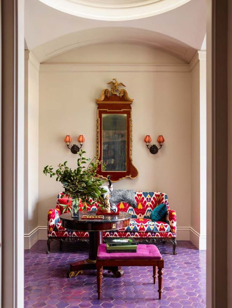 The front hall of Katie Ridder and Peter Pennoyer's home in Millbrook, New York, has a floor of purple Moroccan tiles.