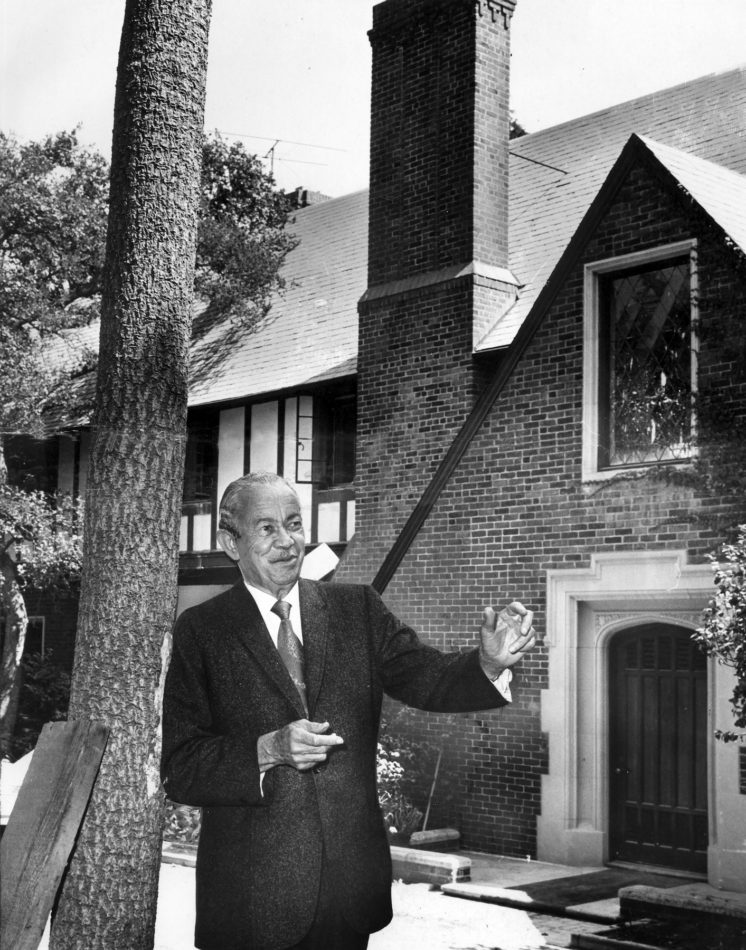 Architect Paul Revere Williams (1894 – 1980) stands before a Tudor mansion that he created in the Bel-Air neighborhood of Los Angeles, California, 1970. Created in 1928, the building was restored in 1970 and named a Design House West by the American Institute of Interior Designers. (Photo by Los Angeles Times via Getty Images)