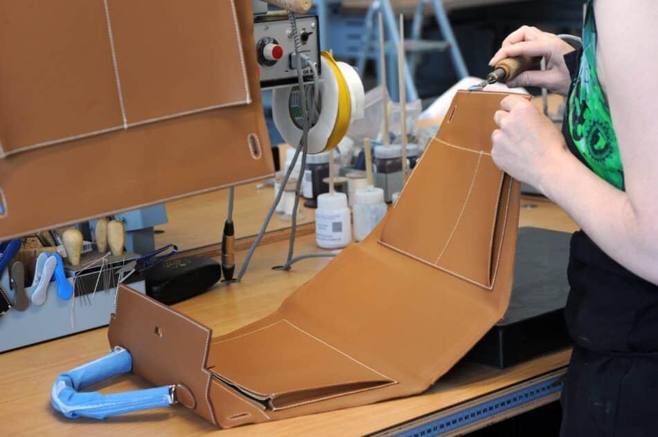 Hermes employee constructing a Kelly bag