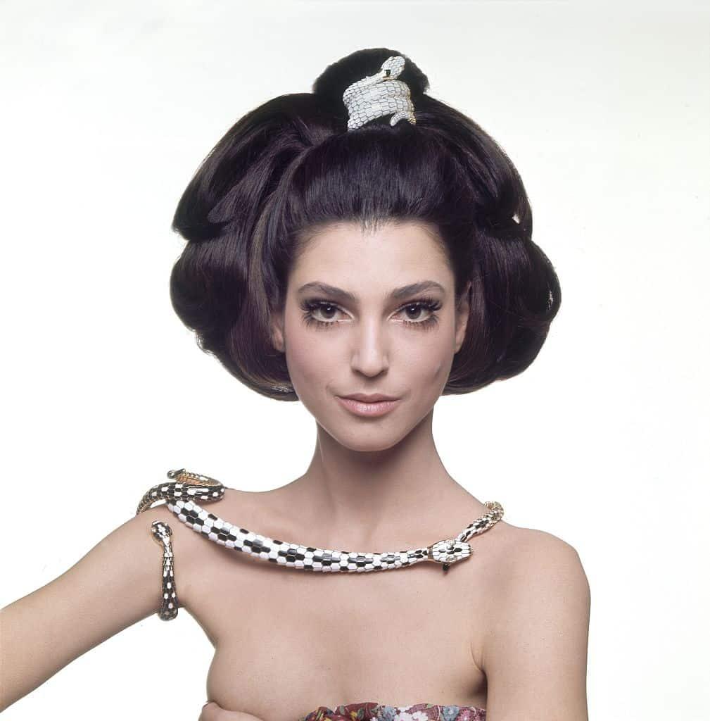 Model Benedetta Barzini wearing an enameled Bulgari Serpenti jewelry