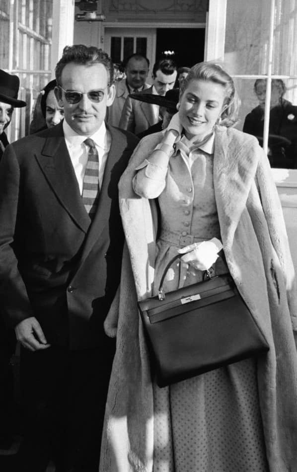 Grace Kelly with a Kelly bag and Prince Rainier