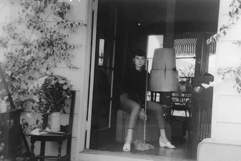 Audrey Hepburn with Broom, 1955, by Milton Greene