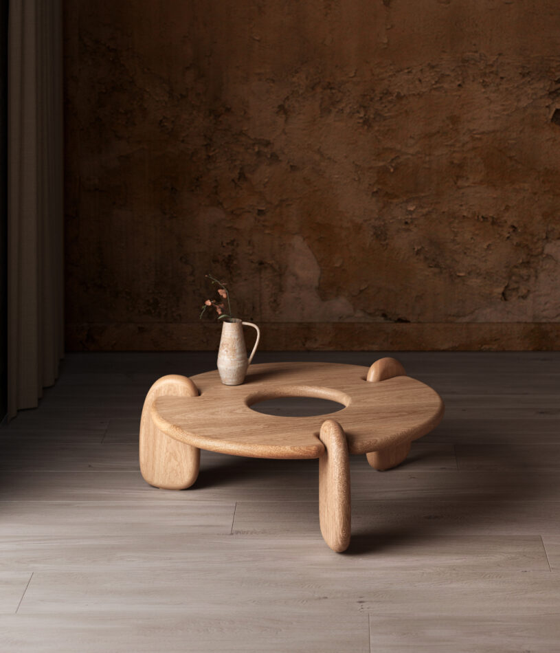 Objects & Ideas Henge Coffee Table in White Oak with a vase of flowers on top