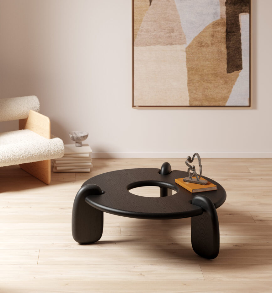Objects & Ideas ebonized-ash Henge coffee table with brown toned painting behind it