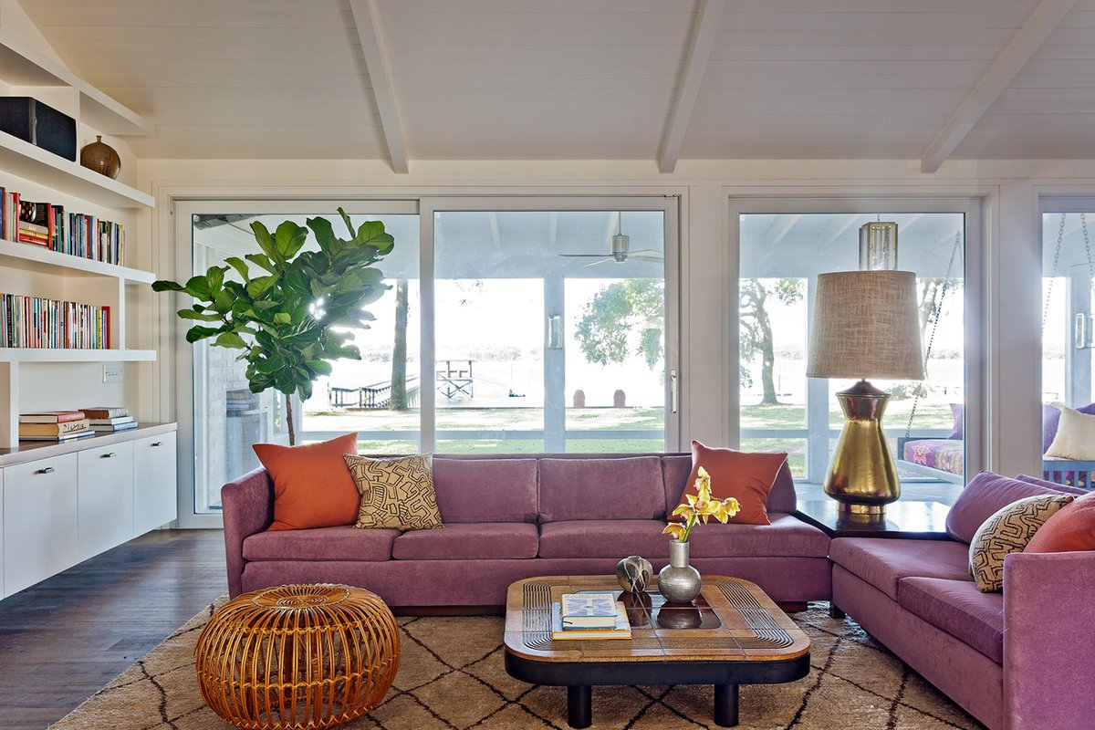 In the South Carolina home of a color-loving family, Angie Hranowsky added a touch of natural texture, with a Franco Albini rattan ottoman.