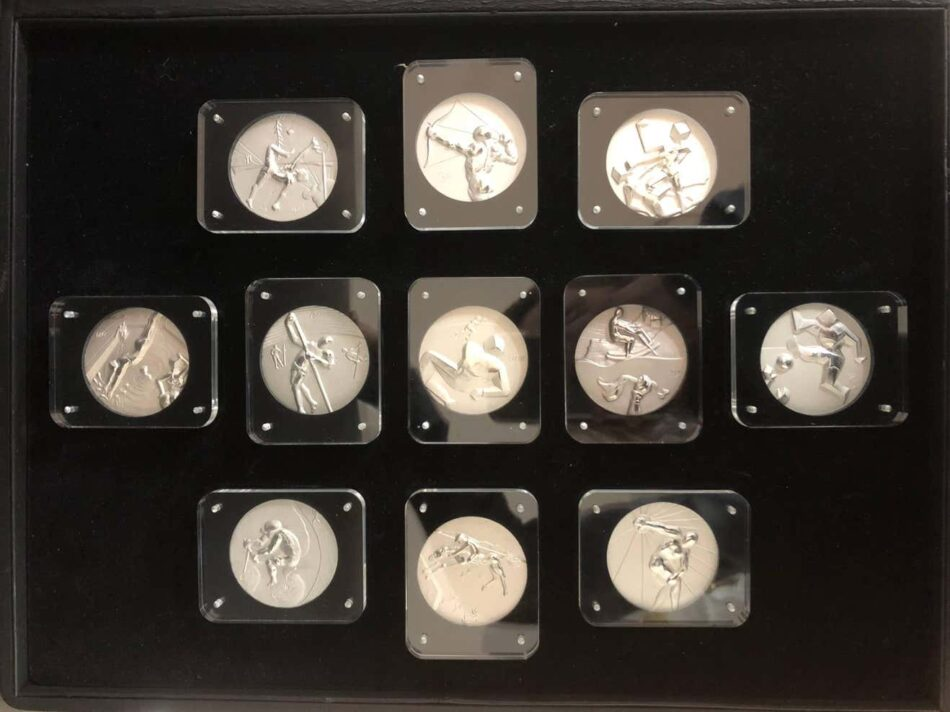 Set of 11 silver Olympic Medallions from 1984 designed by Salvador Dalí depicting different Olympic events
