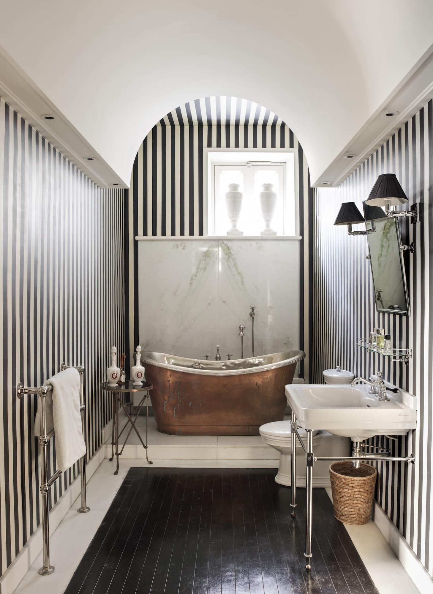 Striped master bathroom in Jamie Creel's Paris apartment