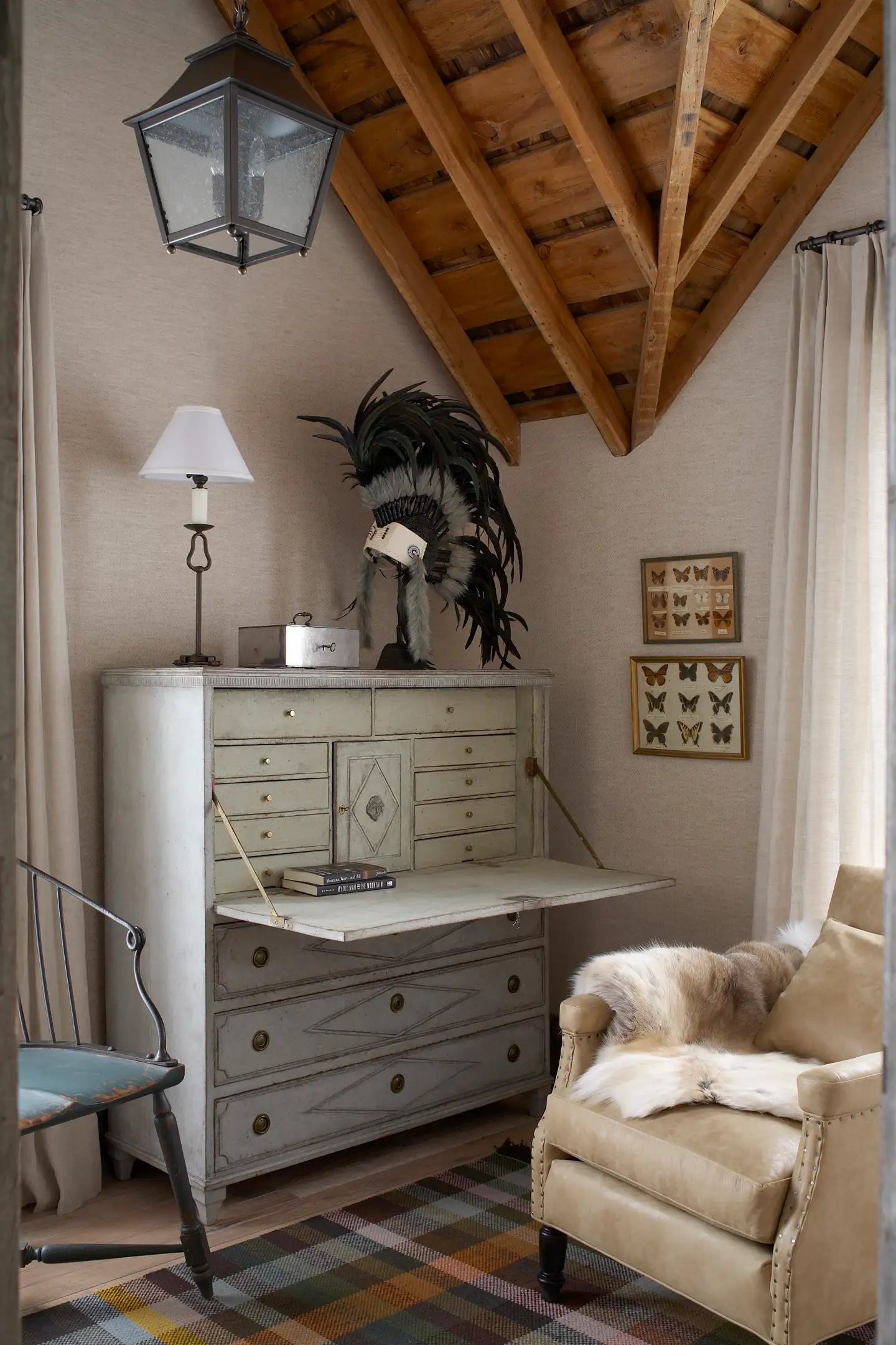 Koo de Kir tucked an antique Swedish secretary into the corner of this cozy study in Montana.