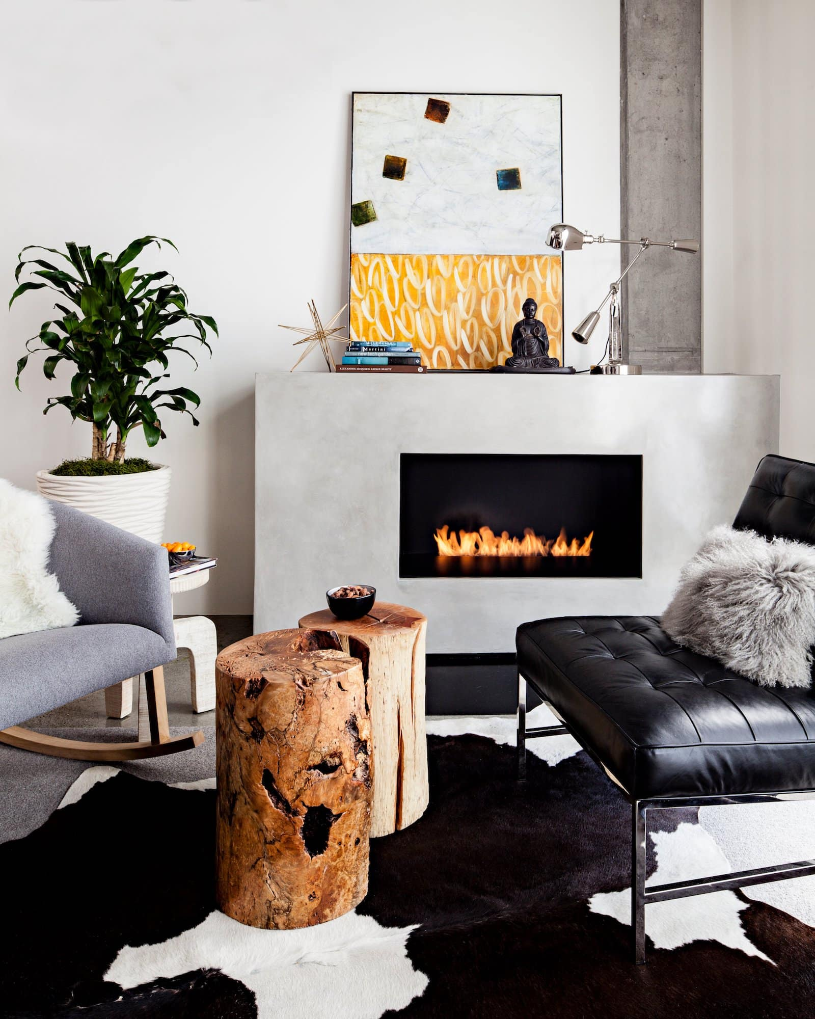 JHL Design added a warm fireplace to this loft in Portland, Oregon.