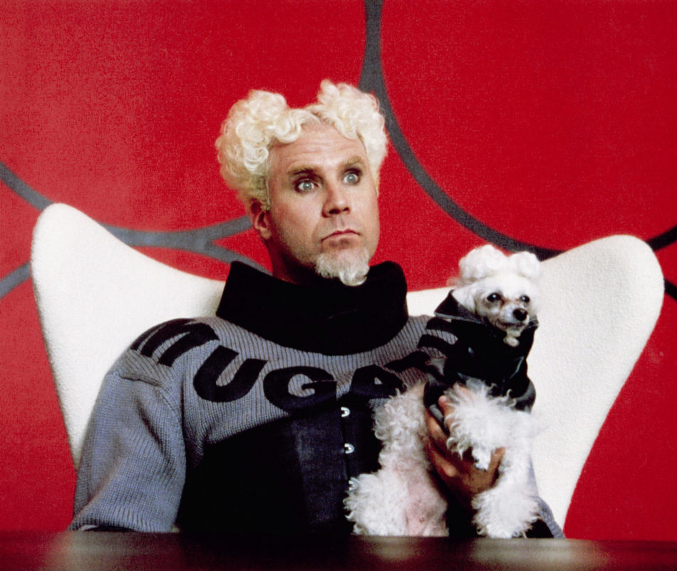 Will Ferrell as Mugatu in Zoolander sits in a white Egg chair.