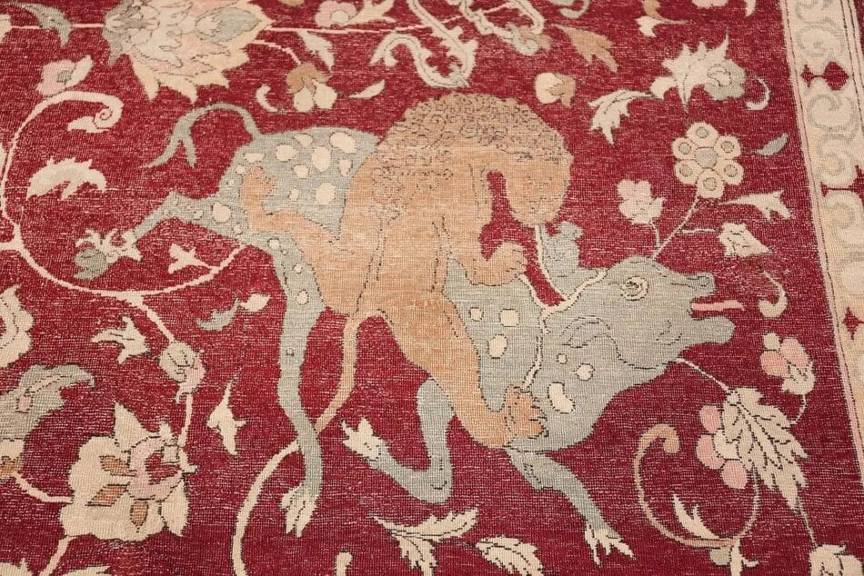 A detail from an 1880 Hereke rug depicts a hunting scene.