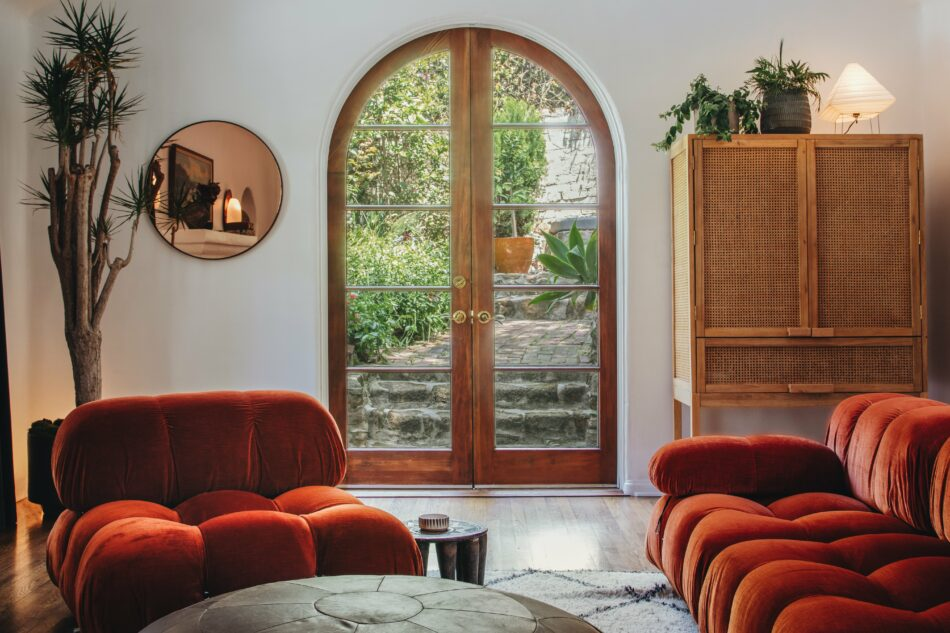 Los Angeles home designed by Night Palm studios, with Camaleonda seating in burnt-orange velvet
