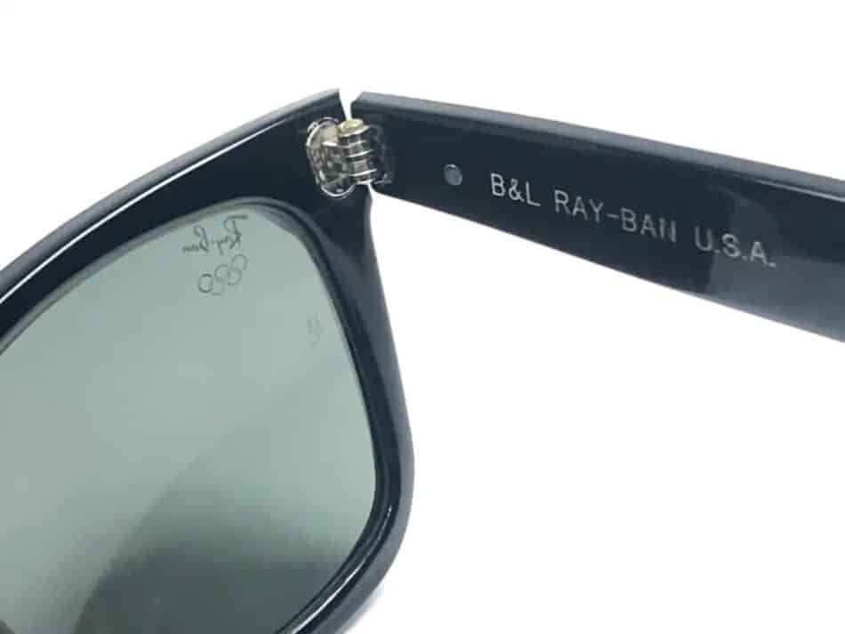 The maker, brand and country of origin printed on the right temple of Wayfarer sunglasses commemorating the 1996 Olympic Games, offered by Nightwings