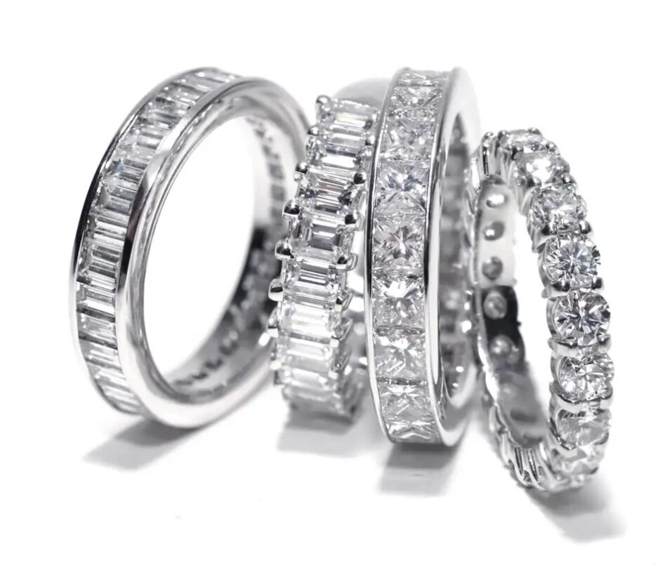 A 2018 OGI Ltd platinum princess-cut-diamond eternity band, second from right, among a selection of other bright and shiny options