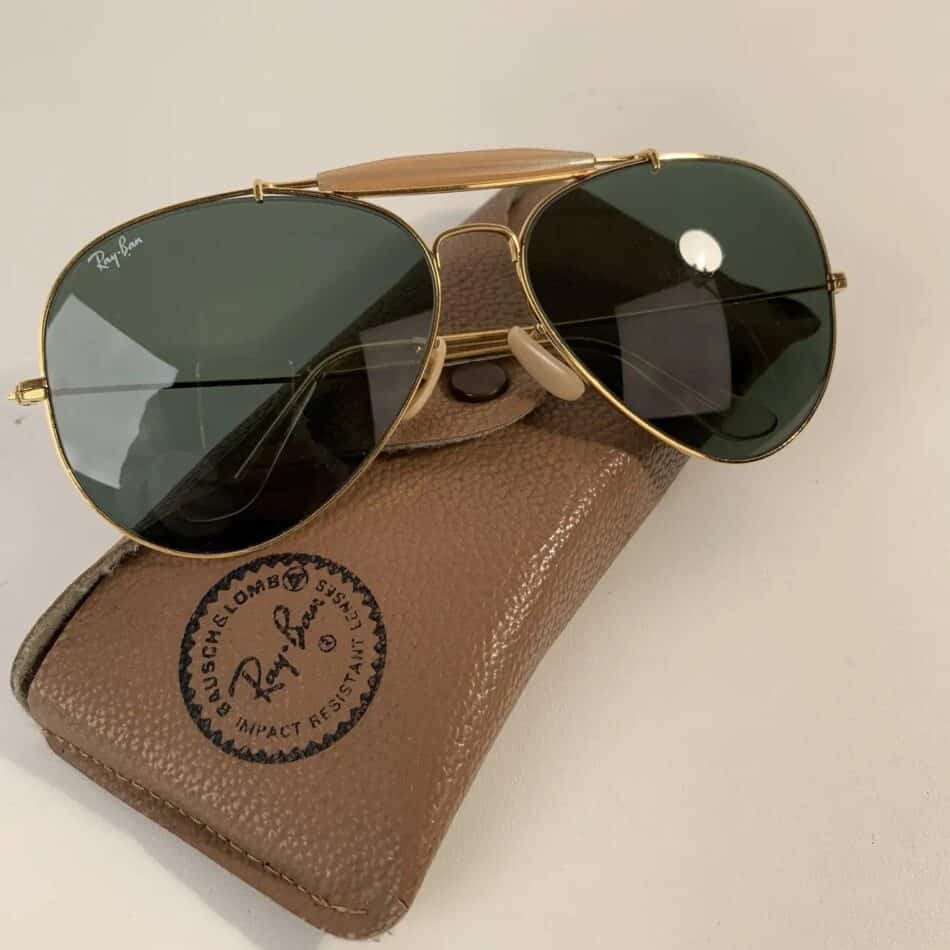A pair of late-20th-century Outdoorsman sunglasses with case, offered by Opherty & Ciocci