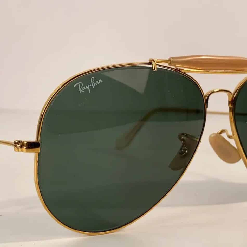 The Ray-Ban signature logo on the right lens of a pair of late-20th-century Outdoorsman sunglasses offered by Opherty & Ciocci