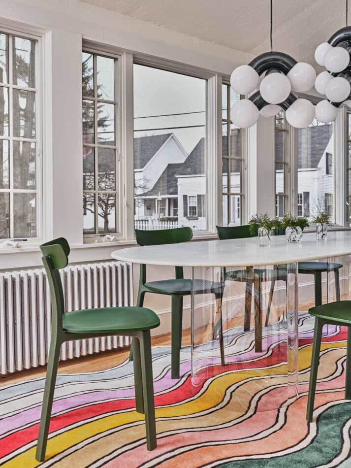 In the dining room, Jasper Morrison for Vitra All Plastic chairs surround a Pieces Court series dining table.