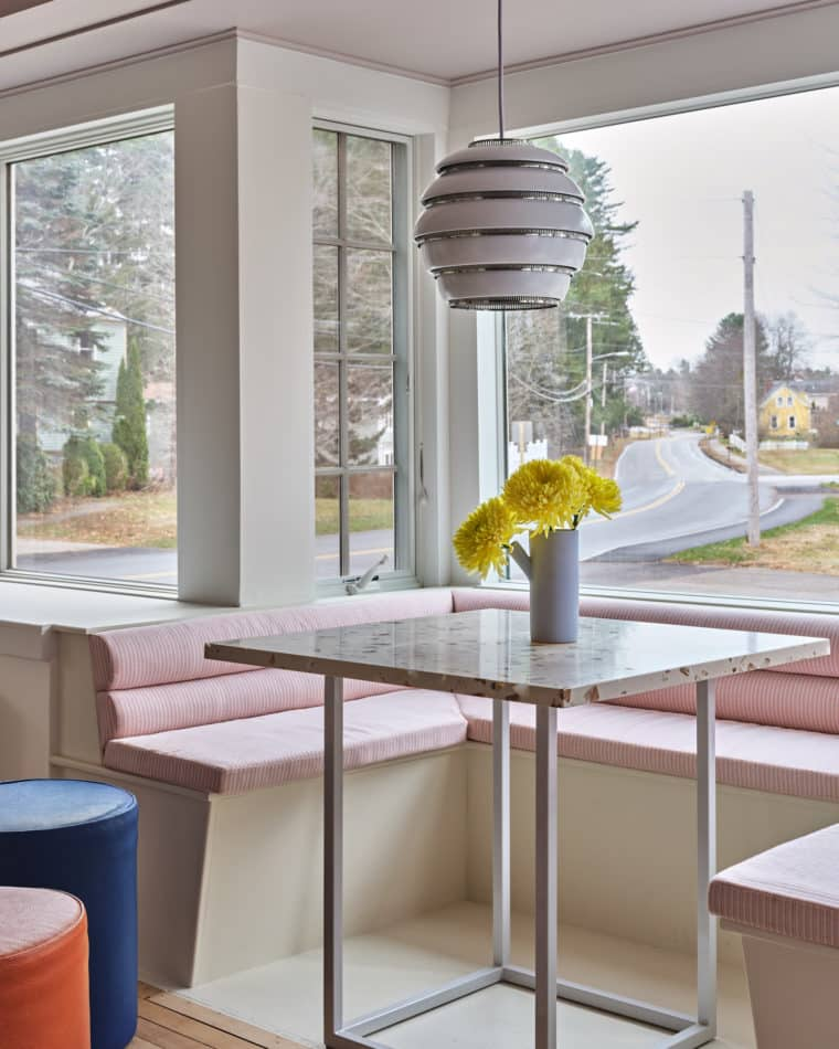 An Artek Beehive light above a Pieces Flux table in the breakfast nook.