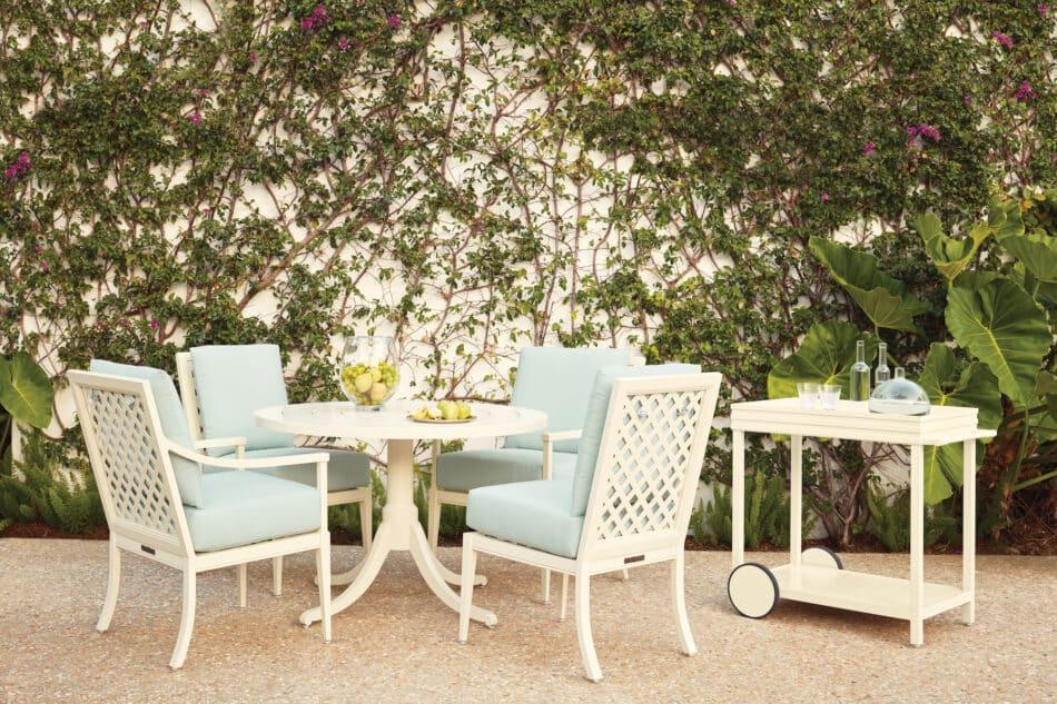 McKinnon and Harris dining furniture in a Mario Nievera–designed garden in Palm Beach.