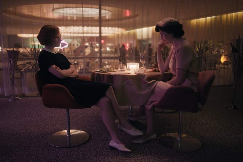 Harmon wears a gender-bending Peter Pan collar in in a very 1960s restaurant scene with her mother, Alma Wheatly.