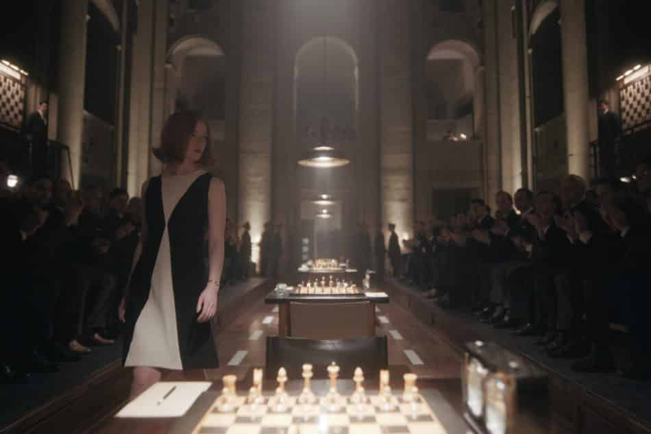 Beth Harmon makes a grand entrance in a chessboard-like black-and-white dress.