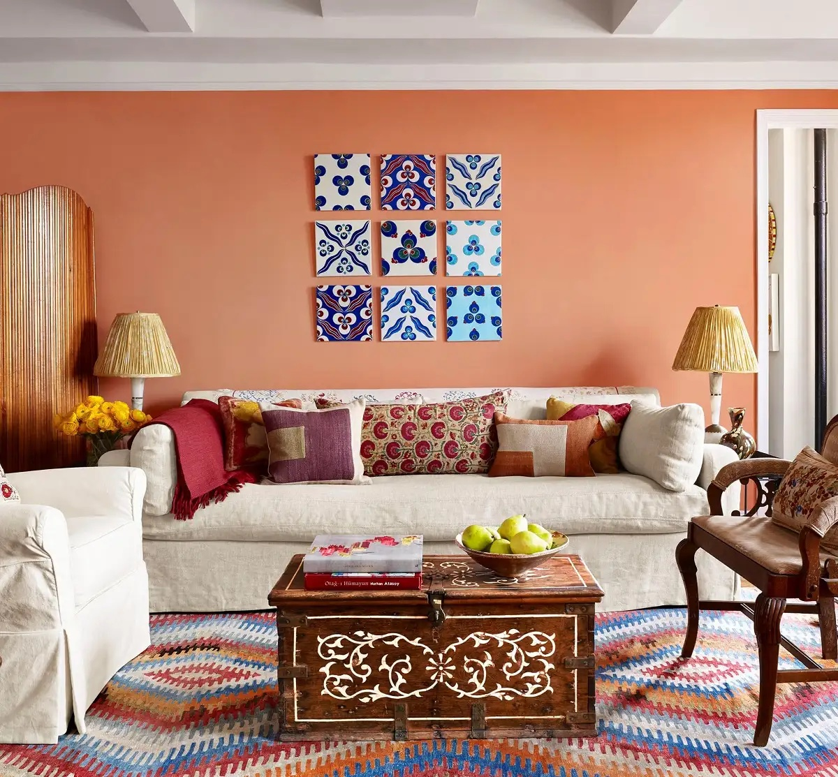 Living room designed by Sara Bengur featuring a colorful Turkish kilim rug