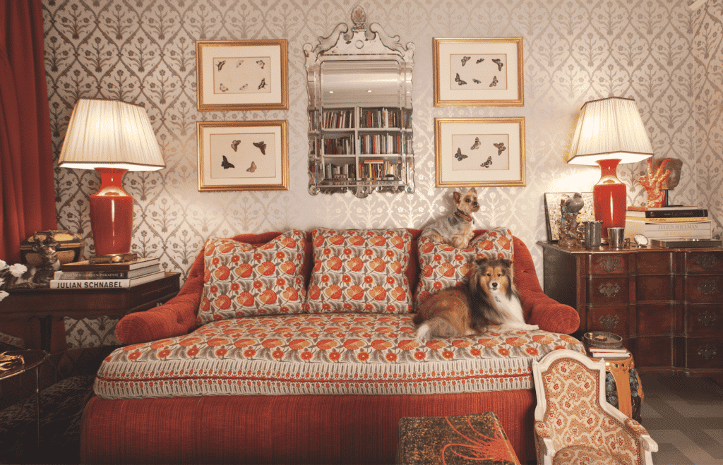 two dogs on a red sofa