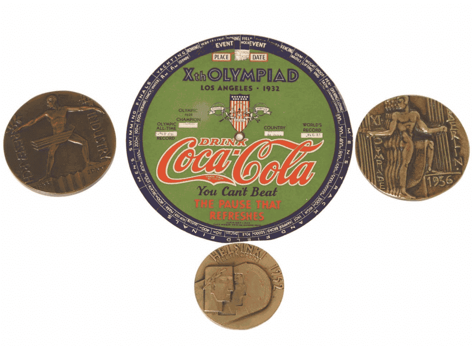 """1933 Chicago World's Fair bronze medallion, 11th Olympiad Berlin 1936 medallion, 15th Olympiad Helsinki 1952 medallion, and 10th Olympiad Los Angeles 1932 Coca Cola manual """"computer"""" that listed events and times"""